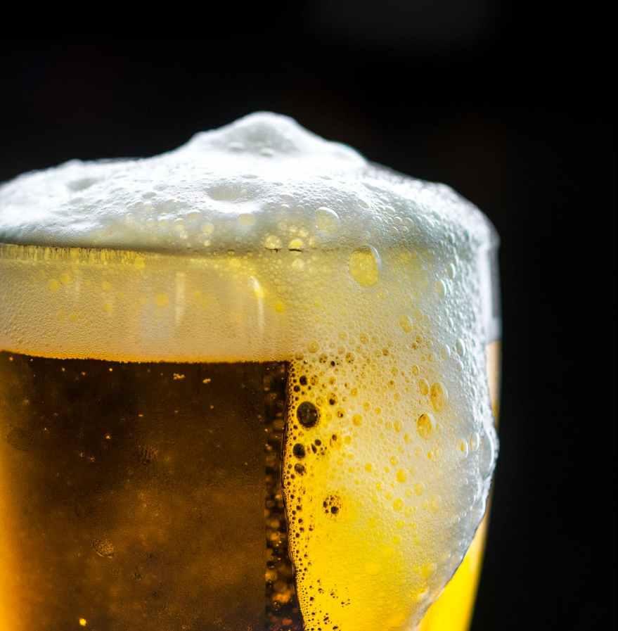 beer foam overflowing glass