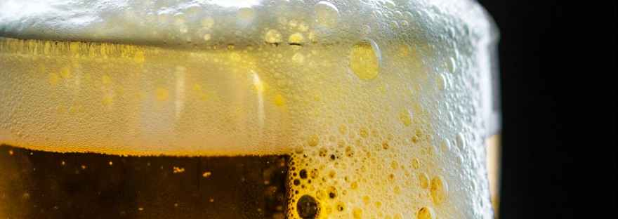 beer foam overflowing glass